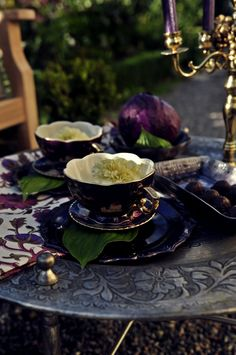 LOVE the colors on this table! Fabulous eggplant purple tea cups! Yum.