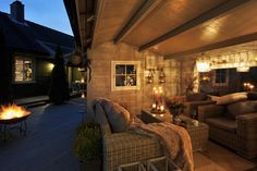 Cozy outdoor space, outdoor living room, blankets, candles
