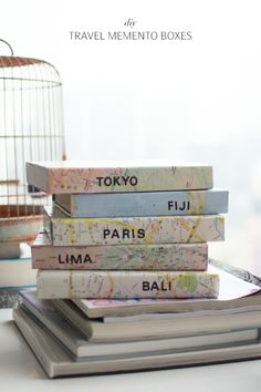 travel memento boxes - cover a box with a map to keep your travel memorabilia (photos, ticket stubs, etc) from each trip