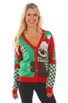 This adorable sloth didn't mean to end up on an ugly Christmas sweater. He just didn't get out of the way in time when we were knitting this design. Now, he's captured forever, embracing a tall pine tree on this charming cardigan.