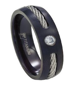 "A single silvery cable runs halfway around the center of this matte black titanium ring, giving it an ""edgy"" urban look. This sleek 7mm band is punctuated by a single CZ. Sleek and elegant, this modern ring can be worn as a fashion ring or wedding band.  Web Page: http://www.justmensrings.com/Mens-Black-Titanium-Cable-Ring-with-Single-CZ-7mm--JT0151_p_892.html"
