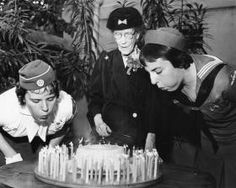 Savannah Morning News-From the collection of the Juliette Gordon Low Birthplace Daisy Philips, 90-year-old freind of Girl Scouts founder Juliette Gordon Low, is flanked by Martha Causey, Left and Ann Martin blowing out candles on a cake in memory of the late Scout organizer on the 99th anniversary of her birth
