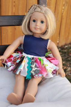 Scrap Fabric American Doll or Bitty Baby   tutu skirts.  I am sure we can do this with a piece of elastic and scrap fabric and ribbon!