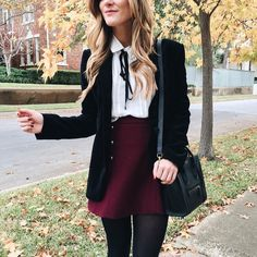 brighton the day styling wine colored skirt, black tights, black jacket, white tie blouse