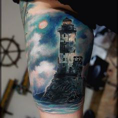 Hyperrealistic lighthouse tattoo half sleeve by Pavel Roch