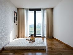 The house locates at a peaceful uncrowded neighborhoods in Binh Chanh Distinct, Ho Chi Minh City, Vietnam. After 10 years working and saving, the couples bought a 7m x 16m ground. They wanted to have a comfortable house for kids: 3 rooms for family...