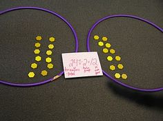 Use hula hoops to teach division!