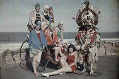 Melville Chater - Women pose in their bathing suits near the beach next to a Zulu man
