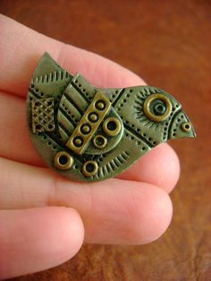 Olive Green and Brass Little Mechanical Birdie - Industrial Steampunk Polymer Clay - Pendant / Necklace. $24.00, via Etsy.