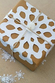Cut-out snowflake wrapping. Repinned by www.mygrowingtraditions.com
