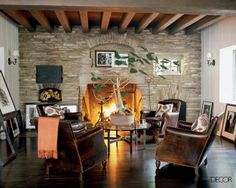Cozy fireplace wall with leather club chairs