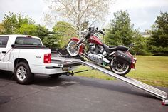 I would love to get a ramp like this for my husband! He loves taking his motorcycle out, but he only rides it around town. If he could load it up in his truck, he could take it where ever he wants!