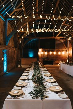 Rustic Barn Reception with Wood Slices, Antlers, Fairy Lights