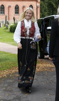 Proud Mette Marit was beautifully turned out in traditional dress to watch her eldest child as he prepared to pass the threshold of manhood.