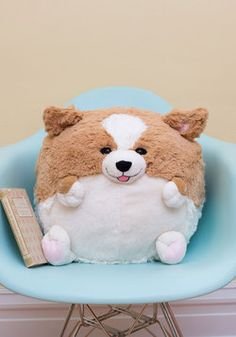 Plush One Pillow in Corgi. Get cozy with this cuddly Corgi pillow bySquishable for a darling day of reading and relaxing! #tan #modcloth