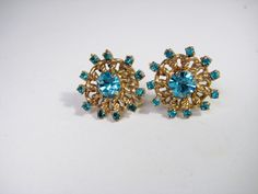 A personal favorite from my Etsy shop https://www.etsy.com/listing/209536775/vintage-blue-rhinestone-screw-on