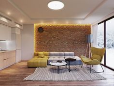 Let exposed brick make a stand in LED-framing. A round circular light sets the stage for quilted block futons and a grey bamboo rug.