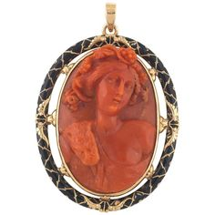 The oval Mediterranean sea Corallium Rubrum cameo depicting probably the Greek God Dionysus wearing a panther skin and bunch of grapes on the head. Mounted in gold and black enamel The pendant 60 mm long, the cameo 45 mm high 31 mm wide Victorian Jewelry, Antique Jewelry, Vintage Jewelry, Black Gold Jewelry, Coral Jewelry, Watch Necklace, Drop Necklace, Pendant Necklace, 14 Karat Gold Chain
