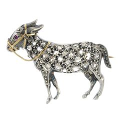 A late 19th century silver and 18ct gold diamond and ruby novelty donkey brooch.