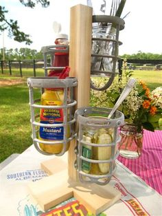 industrial lighting turned condiment holder  this could also be made with little pails or glass jars etc with using the clamp stops used for attaching wires etc