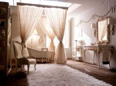 Curtain idea against wall as headboard to create feeling of oppulance.