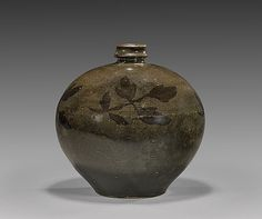 """Chinese Song/Jin Dynasty, Henan glazed meiping vase; of finely potted, squat globular form, decorated with subtle band of foliage sprays; H: 7 1/2"""" (approx.)"""