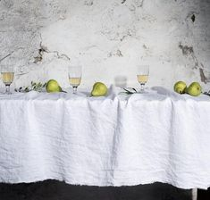 Smooth, fine-quality linen tablecloth in European linen. Raw Edge Linen Tablecloth has a laid-back look with beautiful raw edges set off by a delicate pin-tucked border.