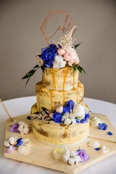 Semi naked wedding cake with toffee sauce and pink and blue flowers Wedding Cakes, Wedding Venues, Toffee Sauce, Informal Weddings, Pink And Blue Flowers, Gingerbread Cake, Engagement Shoots, Flower Decorations, Spring Wedding