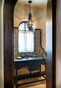 table made into sink, tile backsplash with window, interesting pendant