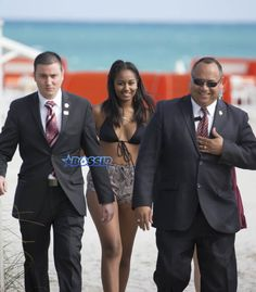 54324b23 Sasha Obama beach in Miami President Obama's daughter Saturday afternoon.  surrounded by secret service agents in plain clothes and hotel security.  black ...
