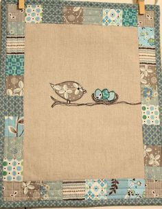 Quilted bird wall hanging - love the machine quilting on this little cutie! Cute idea, quick and easy, could be any motif in the center too. Cute Quilts, Small Quilts, Mini Quilts, Baby Quilts, Quilting Projects, Quilting Designs, Sewing Projects, Bird Quilt, Miniature Quilts