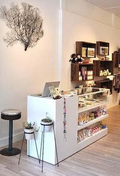Another possible store set-up idea. Love the tree & glass counter.