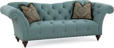 """Ella Sofa   Combine drama and elegance by choosing the Ella Sofa. Notice its reverse camel-back shape and exaggerated flair roll arms. The tufted back and seat, turned legs, and nailhead trim on front and side panels reiterate the beautiful shape. The name means """"girl"""" in Spanish. Coincidence? We think not."""