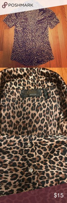 """GUESS cheetah print top with jeweled buttons Get ready to hit the clubs! Show off """"the girls"""" and feel smooth in this low-cut satin-feel top! Guess Tops Blouses"""