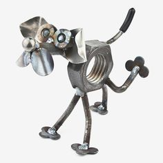 Handcrafted in Kentucky, this humorous Baby Nuts the Bad Boy Dog is made using scrap and reject metal, and features colored glass marble eyes. These quintessentially cute critters make the ultimate gi
