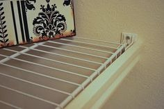 Cover wire shelving with molding...cute!