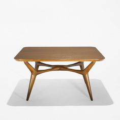 Bertha Schaefer coffee table Singer & SonsUSA/Italy, c. 1955 walnut 34 w x 34 d x 16.5 h inchesSigned with applied manufacturer's label to underside: [M Singer & Sons New York Chicago].v1
