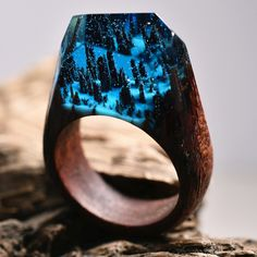 """ENCHANTED FOREST is a ring made with Red Balau, light blue jewellery resin and white """"snow"""" that glows in the dark. It's magically wonderful!"""