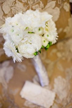 White bouquet of peonies, ranunculus, gerbera daisies, mini calla lilies, and hypericum berries. designed by: Flower Bar