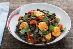 Squid Ink Linguine Pasta with Shrimp & Cherry Tomatoes - Fresh squid ink pasta is an incredibly delicious, gourmet ingredient. To make it, squid ink is mixed right into fresh pasta dough, turning it a gorgeous, dark hue and infusing it with a light salinity that pairs perfectly with shellfish. https://www.blueapron.com/recipes/squid-ink-linguine-pasta-with-shrimp-cherry-tomatoes