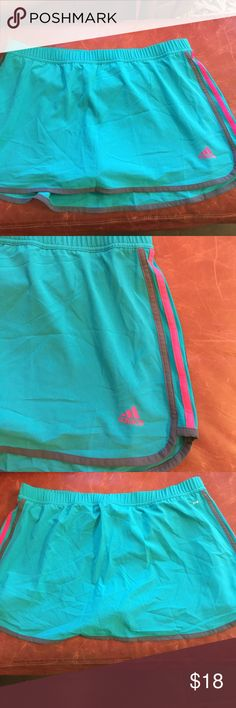 Adidas Skorts - size Large - Skorts is 86% polyester 14% spandex, shorts are 92% polyester 8% spandex, dark turquoise. Waist is elastic with a drawstring, about 34 inches. The length is about 14 inches. Brand new never used adidas Shorts Skorts