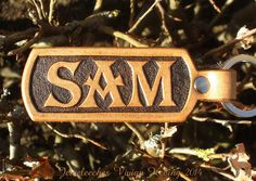 Jeweleeches Vivian Hebing handmade leather keychain with the name SAM