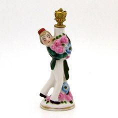 Vintage Art Deco Bellhop Hotel Porter with Flowers German Figural from charmalier on Ruby Lane