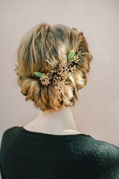 Beautiful wedding updo with unique floral detail