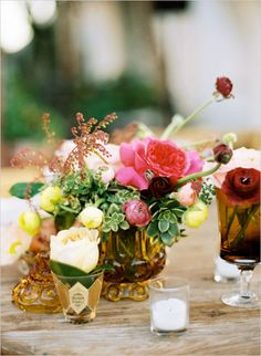 colorful floral centerpieces in amber glass http://www.weddingchicks.com/2013/12/02/coastal-wedding/