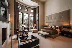 Modern luxury Master Bedroom....needs a splash of color in there, though....flowers, candles!