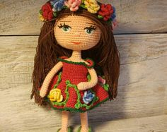 Doll. Toy handmade. Amigurumi. Doll with flowers. Knitted toy. Toy for decoration. Gift for children.
