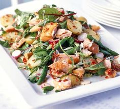 Hot-smoked salmon salad with a chilli lemon dressing. This delicious salad is thrown together in minutes to make a fresh, seasonal dish that's stylish enough for entertaining