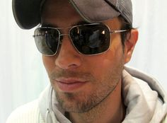 Eye-Swoon »  Latin groove master Enrique Iglesias wears the jet-set standard Michael Kors style MKS153M from Marchon Eyewear.
