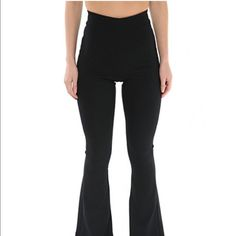 The Line by K Carmen Pant Karla Deras CARMEN PANT- BLACK The Carmen pants are made from black ponté and feature a high waist, flared silhouette, and back zip closure. They are slightly stretchy and are meant to fit closely to your body. We love them with a worn-in leather jacket or a fancy bustier!  * Rayon/nylon/spandex  * Runs true to size, take your normal size  * Machine wash cold.                                       This line is owned and designed by Karla Deras.    I got XS but I…